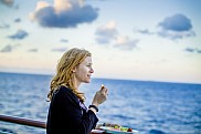 Woman on  stateroom balcony.