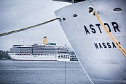 Arcadia sailing from Oslo while Astor is at port.