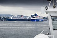 Queen Mary 2 (Left) and Crown Seaways seen from local ferry in Oslo, Norway.
