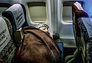Arafat resting during a flight.