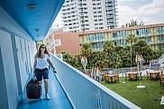 Woman carry luggage at hotel
