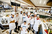 Ovation of the Seas. Crew at Windjammer Marketplace restaurant.